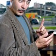 Funny portrait of a man with mobile phone outdoors — Stock Photo