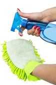 Female hand holding spray bottle and duster — Stock Photo