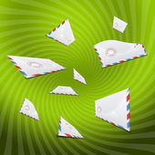 Lot of envelopes on green background — Stock Photo