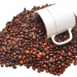 Coffee beans falling from a coffee cup — Stock Photo #3596996