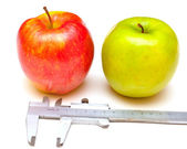 Red and green apple measured — Stock Photo