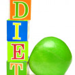 Royalty-Free Stock Photo: Green apple and cubes with letters - diet