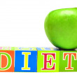 Green apple and cubes with letters - diet — Stock Photo