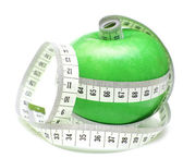 Tape measure wrapped around green apple — Stock Photo