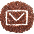 Envelope icon is lined with coffee beans - Photo
