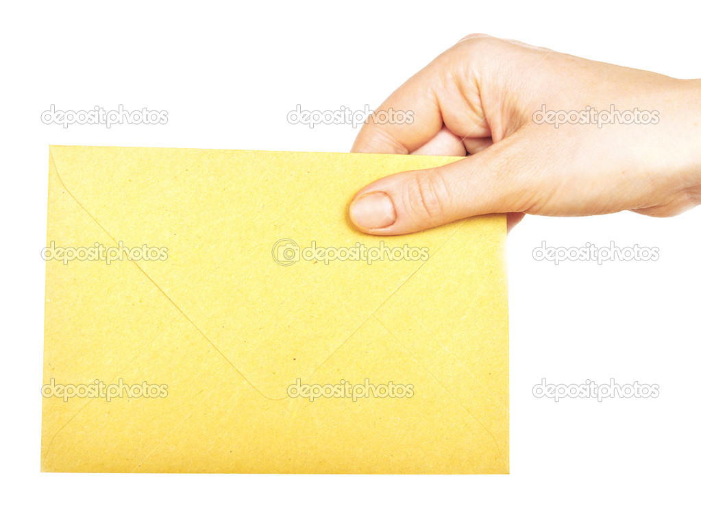 Yellow envelope in the hand isolated on white background  — Stock Photo #3790322