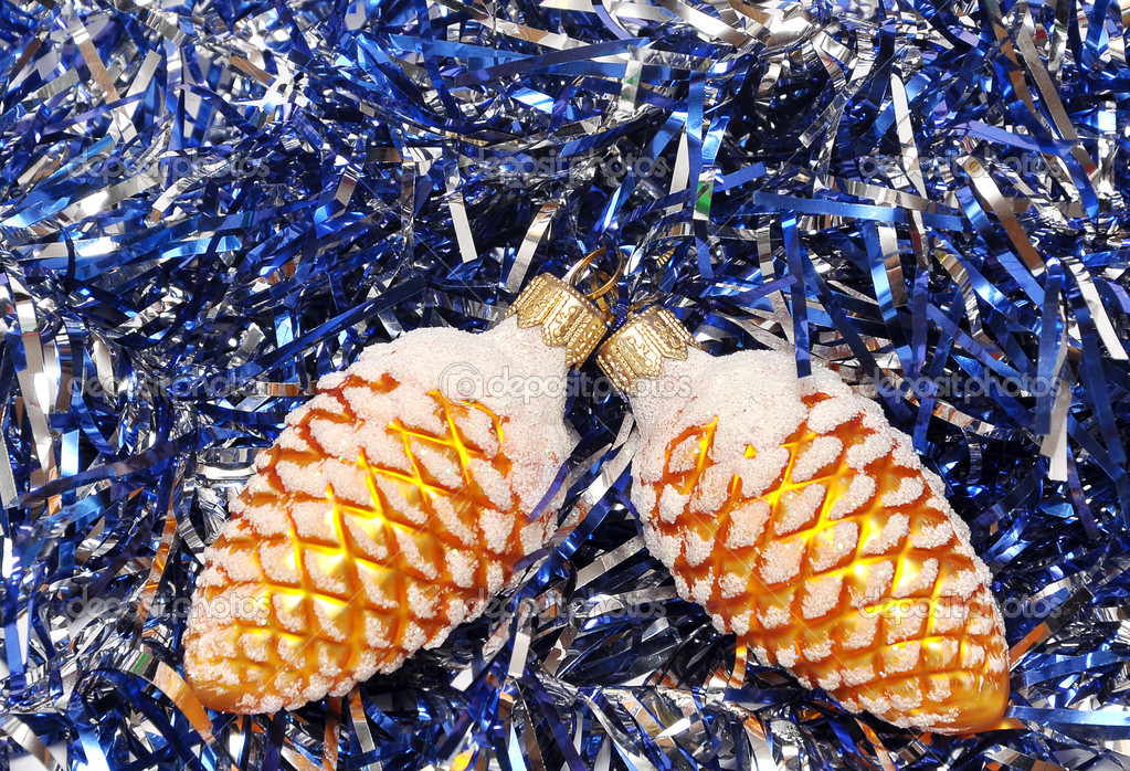 Christmas tree decoration lie over blue tinsel — Stock Photo #3840846