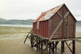 Boathouse in tide — Stock Photo