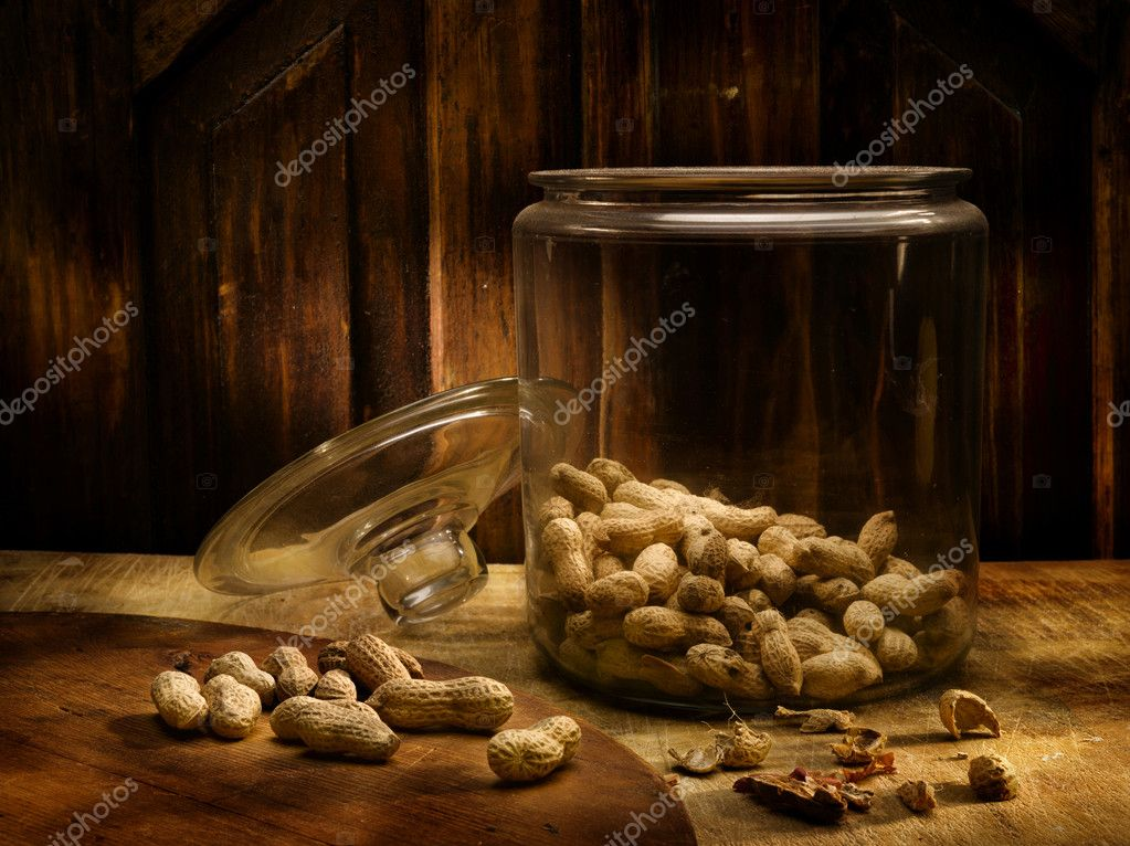 Peanuts in a pot of glass in an antique environment  Foto Stock #3496733