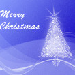 Christmas tree on blue swirl background with 'Merry Christmas' — Stock Photo