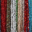 Strings of natural irregular beads — Stock Photo