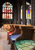 Empty colorful benches of church — Stock Photo