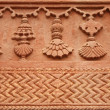 Carved decorative pattern on stone — Stock Photo