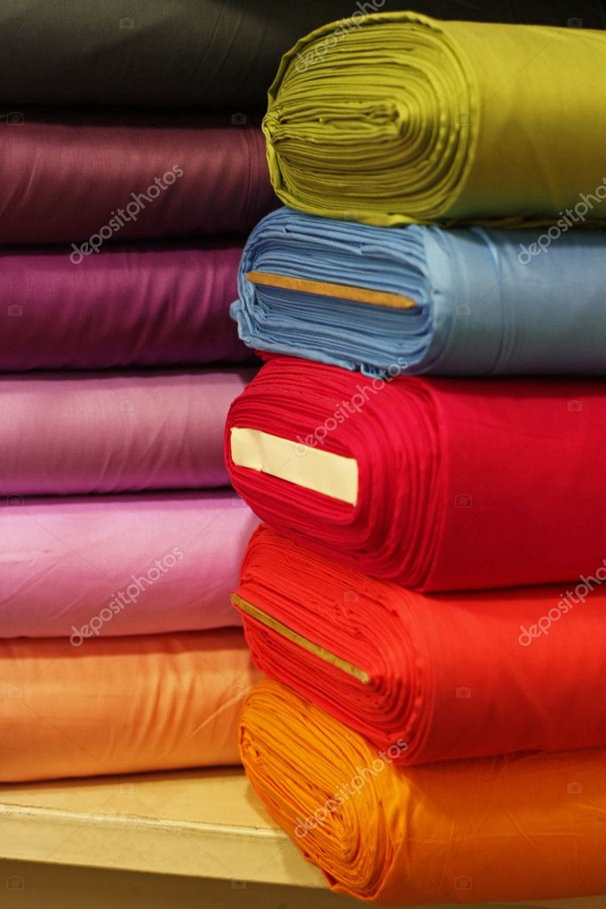 Piles of colorful textiles in a fabric store. — Stock Photo #3471192