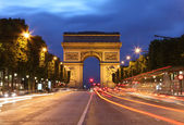 Arc De Triomphe and light trails — Stock Photo