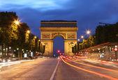 Arc De Triomphe and light trails — Stock Photo