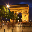 Arc De Triomphe and ghost of pedestrians — Stock Photo