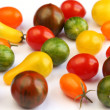 Varieties of tomato on white fabric — Stock Photo