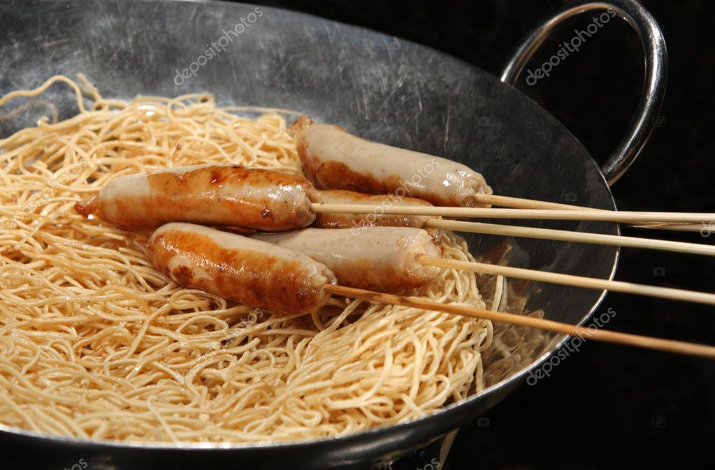 Steam cooked sausages in a pot of noodles. — Stock Photo #3772902