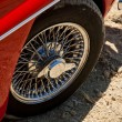 Vintage red car wheel close-up — Stock Photo