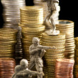 Small toy soldiers defend euro coins — Stock Photo #3868610