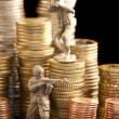 Small toy soldiers defend euro coins — Stock Photo