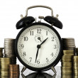 Royalty-Free Stock Photo: TIME IS MONEY concept: alarm clock and lots of euro coins