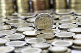 Grungy 2 euro coin with coins on background — Stock Photo