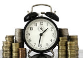 TIME IS MONEY concept: alarm clock and lots of euro coins — Stock Photo