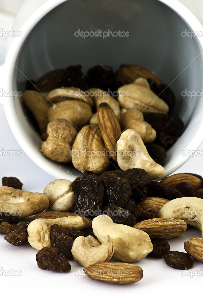 Isolated Spilled mixed nuts on white background — Stock Photo #3866297