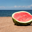 Watermelon on beach — Stock Photo