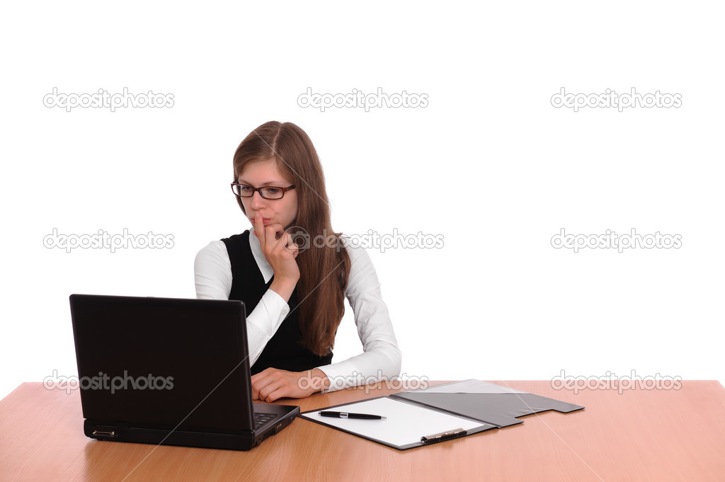 A successful business woman working on a laptop computer at her desk isolated over white background — Photo #3480351