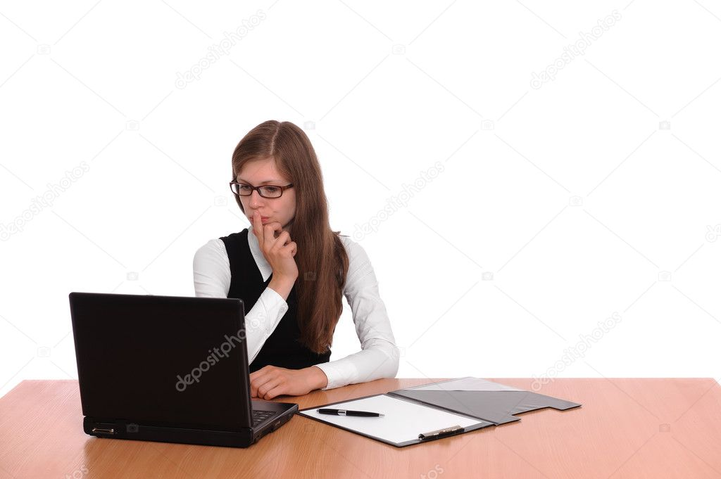 A successful business woman working on a laptop computer at her desk isolated over white background   #3480351