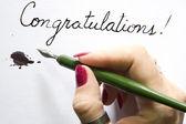 Hand writing congratulations — Stock Photo
