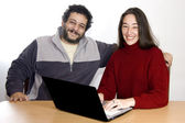 Middle-aged couple with laptop — Stock Photo