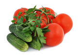 Tomatoes, cucumbers and parsley — Stock Photo