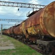 Train transports old tanks — Stock Photo