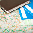Stock Photo: Preparing to travel: passport, tickets, map