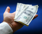 Dollars are in a hand — Stock Photo
