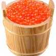 Red caviar is in a wooden bucket - Stock Photo