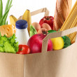 Paper bag with food on white background — 图库照片 #3598804