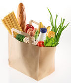 Paper bag with food on a white background — Stockfoto