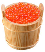 Red caviar is in a wooden bucket — Stock Photo
