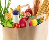 Kağıt torba gıda üzerinde beyaz bir arka plan ile — Stok fotoğraf