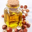 Filbert oil with nuts - Stock Photo