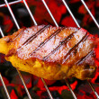 Steak on a grill — Stok fotoğraf
