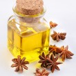 Aniseed oil with nuts — Stock Photo