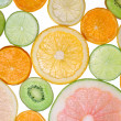 Brighten citrus slices  on a white - 图库照片