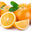 Stock Photo: Oranges with segments on a white background