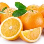 Oranges with segments on a white background — Stock Photo